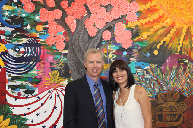 Craig and Yazmin in front of mural